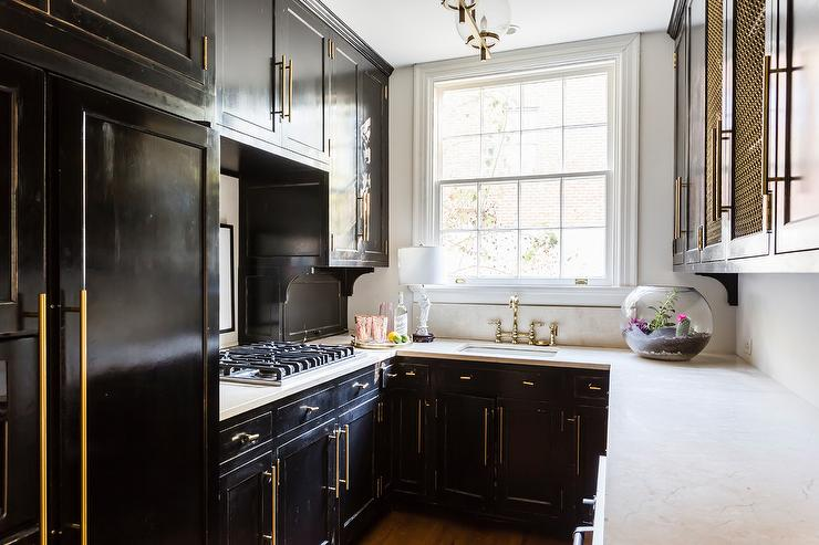 kitchen black cabinets valances design ideas small contemporary u shaped features glossy accented with brass hardware and a white quartz countertop