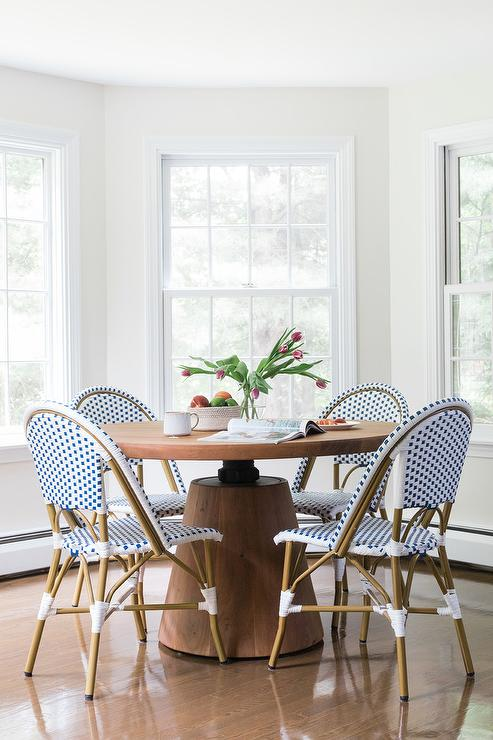 blue bistro chairs pink arm chair french with wood pedestal table transitional