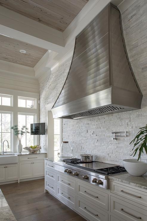 white stone backsplash tiles