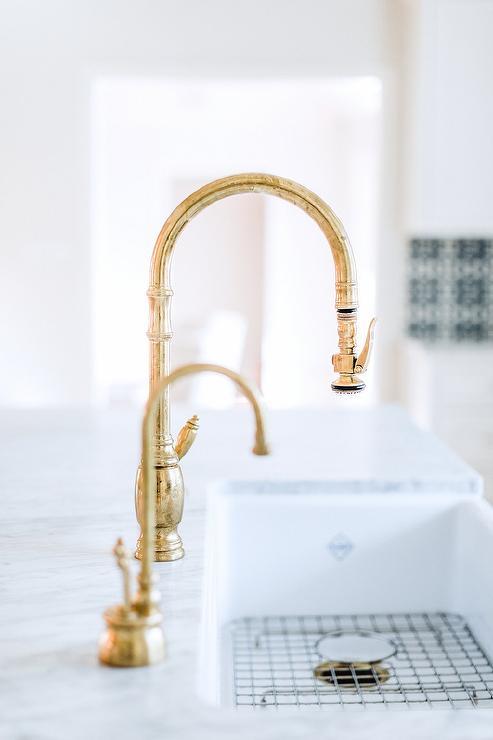 antique brass gooseneck faucet on farm