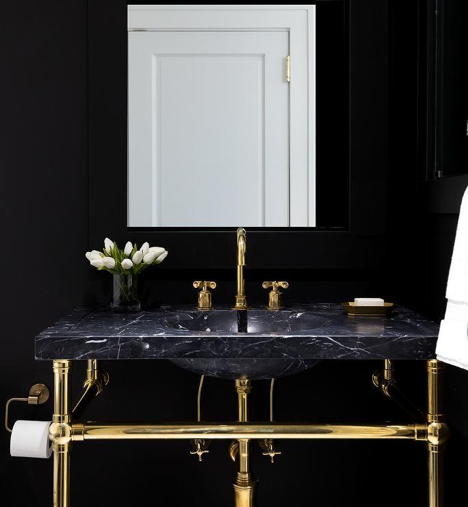 black marble and brass sink vanity on