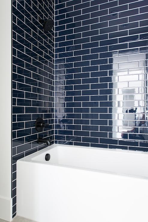 Blue Grid Shower Floor Tiles With White Geometric Wall