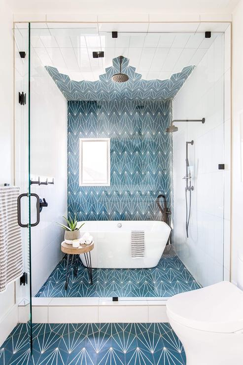 shower with tub and blue cement tiles