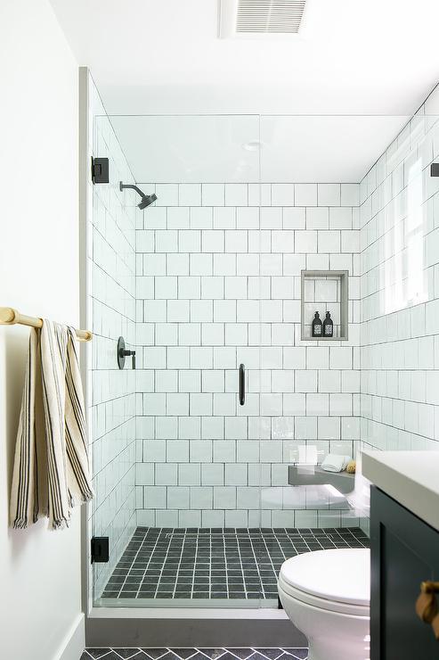 black grid shower floor tiles