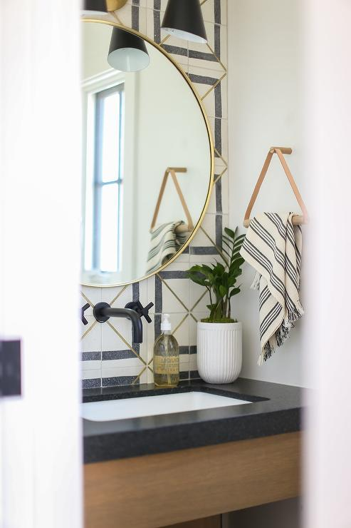 brass inlay tiles with black and white