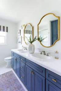 Brass Vanity Mirror with Brass Swing Arm Sconce ...