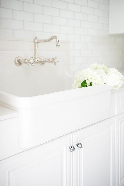 laundry room farmhouse sink with subway