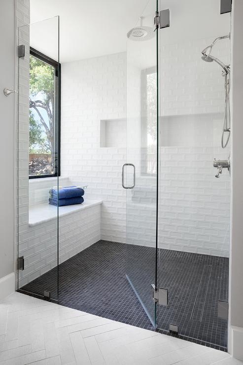 white shower wall tiles with black grid