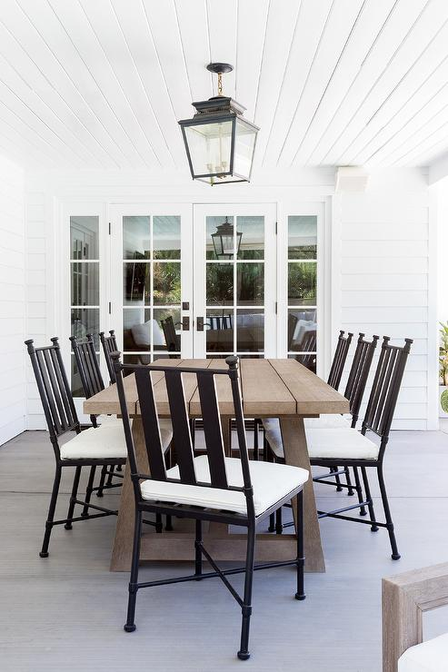 brown outdoor dining table with black