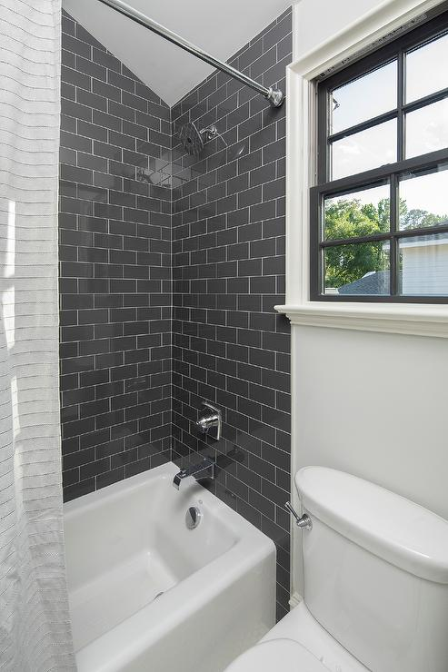 black subway shower wall tiles with
