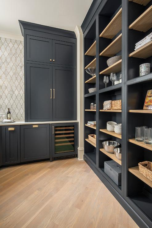 Black Shaker Pantry Cabinetry With Blond Wooden Shelves Transitional Kitchen