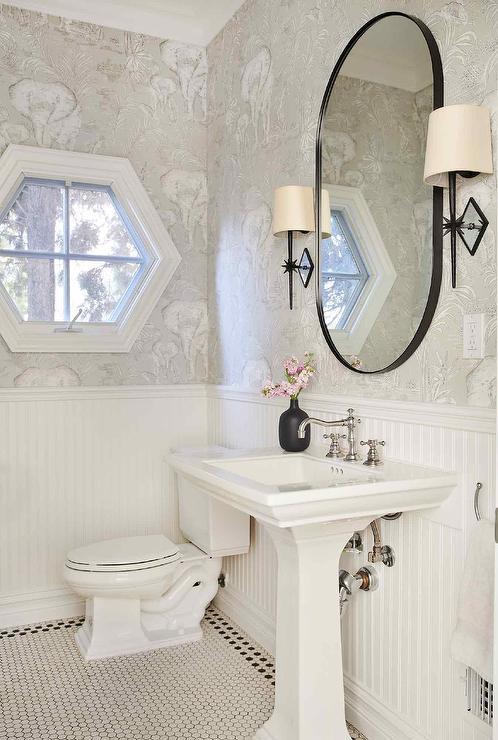 oblong black mirror over white pedestal