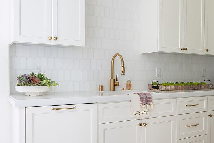 white and gold backsplash tiles design
