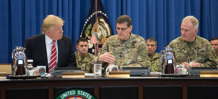 """President Donald Trump discusses current military operations with Gen. Joseph Votel, commander of U.S. Central Command Commander, and Gen. Raymond A. """"Tony"""" Thomas, U.S. Special Operations Command Commander at MacDill, AFB, FL, Feb. 6, 2017."""