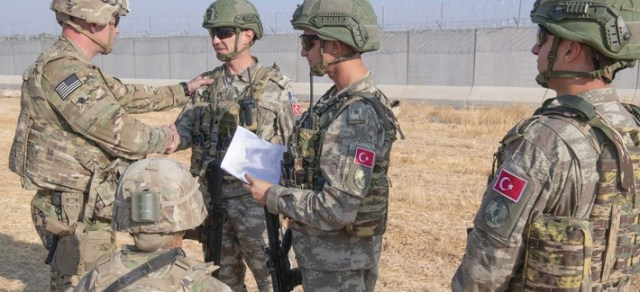 U.S. and Turkish military forces conduct the third ground combined joint patrol inside the security mechanism area in northeast Syria, Oct. 4, 2019.