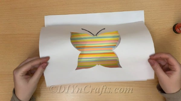 Cover colored strips with printable butterfly template and glue into place