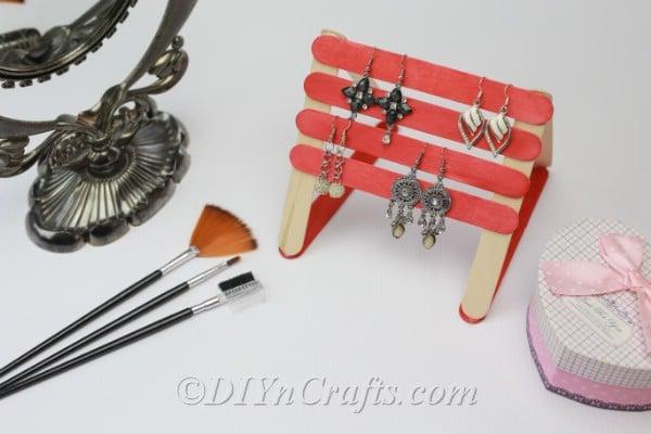 Earrings on popsicle stick earring organizer