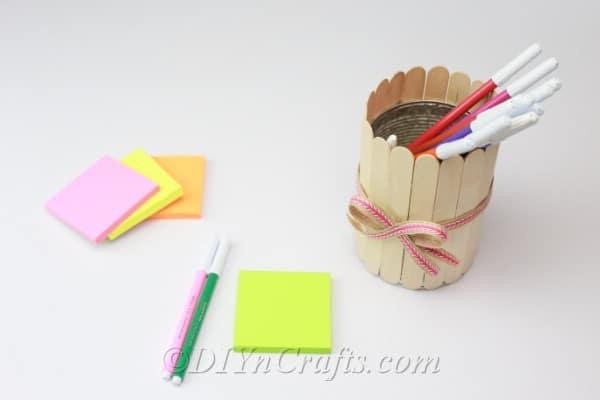 Popsicle stick pencil holder on a desk