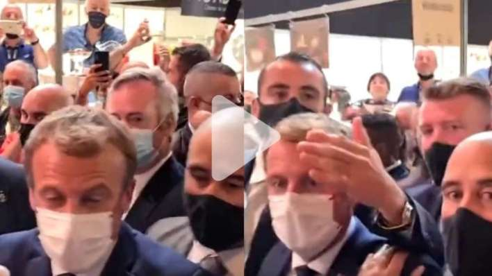 On camera, French President Emmanuel Macron hit by an egg during public visit - WATCH