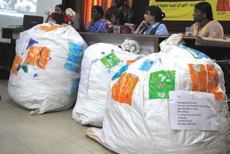 Members of SWaCH at a press conference with bags of soiled sanitary napkins addressed to the manufacturers (Photographs Courtesy : SWACH)