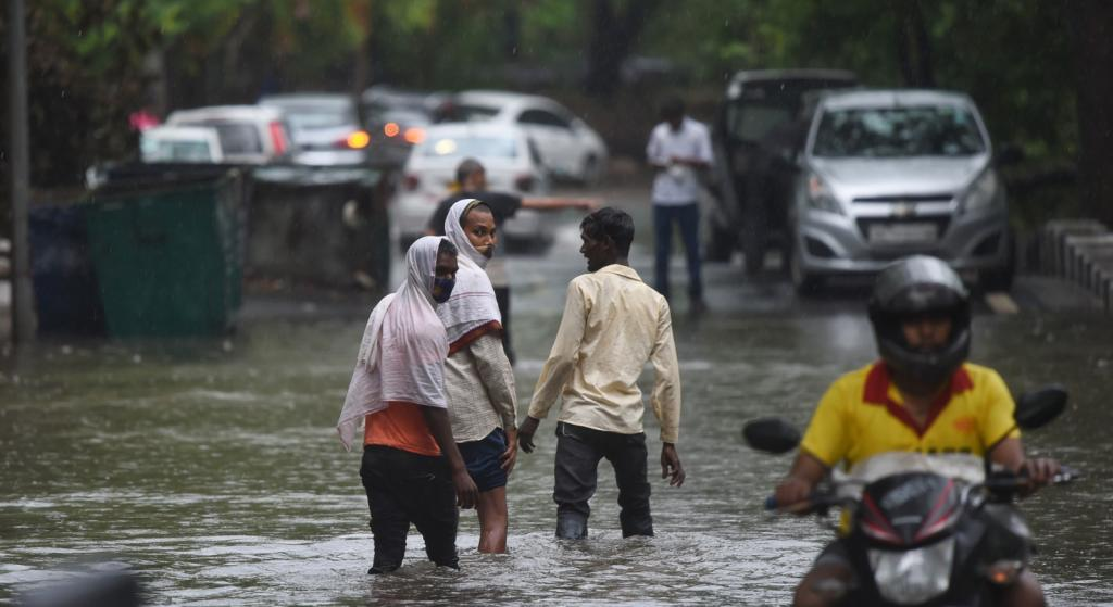 The heavy showers led to several roads being inundated, the Delhi Traffic Police said. A portion of the road caved in the city's Dwarka region and car got stuck in it. No injuries were reported. Photo: Vikas Choudhary