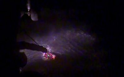 An MH-60 Jayhawk helicopter crew from Coast Guard Air Station Kodiak hoists a hunter from a life raft after his vessel sunk in Three Saints Bay, Alaska, Sept. 17, 2019. The aircrew transported the hunter, who was in good condition and required no medical care, to Kodiak. U.S. Coast Guard video courtesy of Air Station Kodiak.