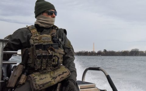 A crewmember from Maritime Security Response Team-East, located in Chesapeake, Va., looks on during a security patrol on the Potomac River in Washington ahead of the 2021 Presidential Inauguration, Jan. 16, 2021. On Sept. 24, 2018, the Department of Homeland Security designated the Presidential Inauguration as a recurring National Special Security Event. Events may be designated NSSEs when they warrant the full protection, incident management and counterterrorism capabilities of the Federal Government. (U.S. Coast Guard photo by Petty Officer 3rd Class Kimberly Reaves/Released)