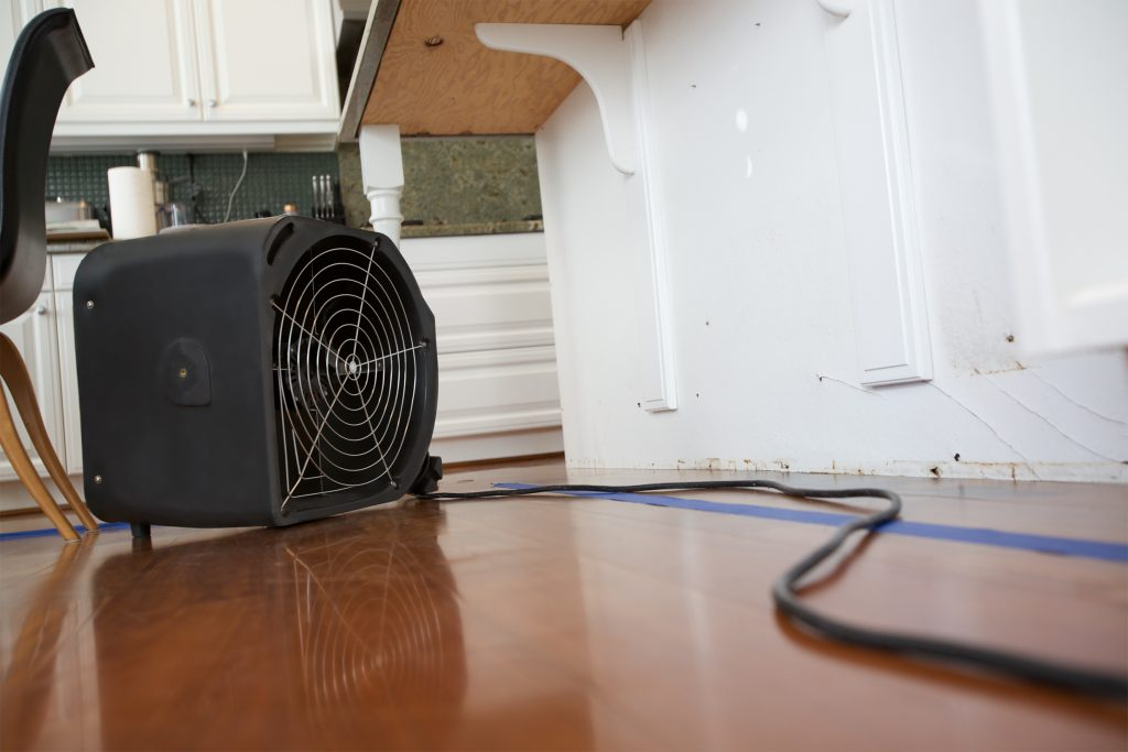 how to dry out cabinets after water