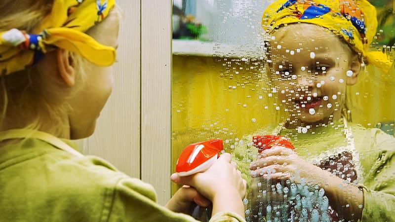 Child with spray bottle