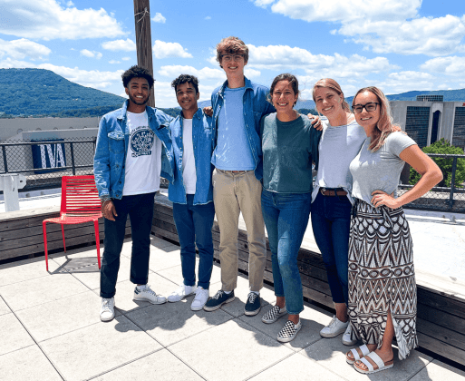 This photo shows six college students from UNC standing on the roof of the Edney Innovation Center in Chattanooga, posing for a photo.