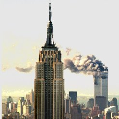 Smokes billows from the World Trade Center towers in New York Tuesday, Sept. 11, 2001, after two aircraft hit the upper floors of the buildings. The Empire State Building is in the foreground. (AP Phoito/Marty Lederhandler)