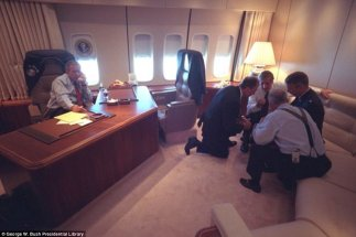 4424f85400000578-4871706-president_bush_is_pictured_above_talking_on_the_telephone_on_sep-a-6_1505109854626