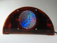 Bulbdial clock with tortoiseshell acrylic case.