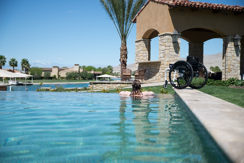 wheelchair meaning in urdu chair pillow for back pain india have travel anywhere pool photo codi darnell