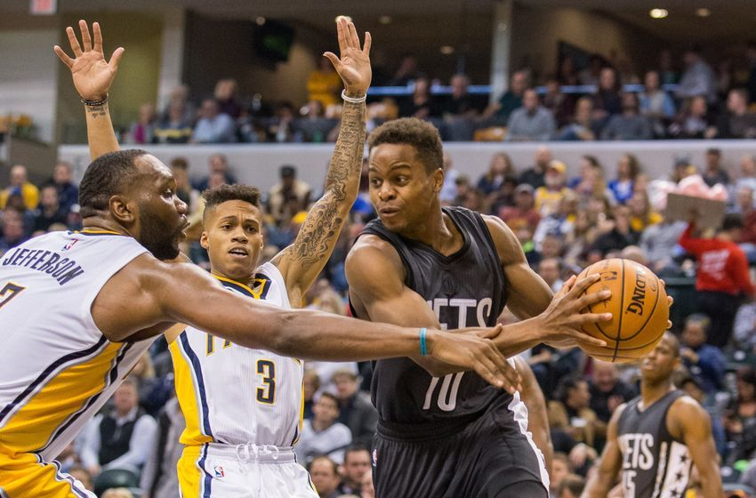 Nov 25, 2016; Indianapolis, IN, USA; Brooklyn Nets guard Yogi Ferrell (10) passes the ball while Indiana Pacers center Al Jefferson (7) defends in the second half of the game at Bankers Life Fieldhouse. The Indiana Pacers beat the Brooklyn Nets 118-97. Mandatory Credit: Trevor Ruszkowski-USA TODAY Sports
