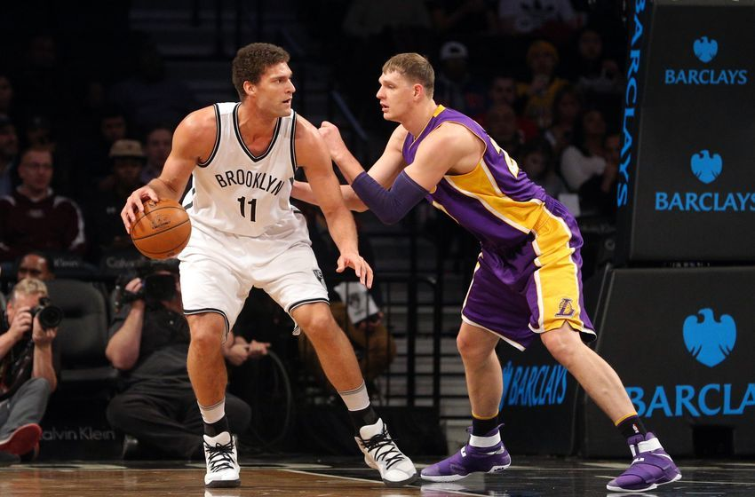 Dec 14, 2016; Brooklyn, NY, USA; Brooklyn Nets center Brook Lopez (11) controls the ball against Los Angeles Lakers center Timofey Mozgov (20) during the first quarter at Barclays Center. Mandatory Credit: Brad Penner-USA TODAY Sports