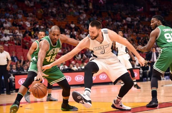 Dec 18, 2016; Miami, FL, USA; Boston Celtics center Al Horford (42) and Miami Heat forward Josh McRoberts (4) case a loose ball during the first half at American Airlines Arena. Mandatory Credit: Steve Mitchell-USA TODAY Sports