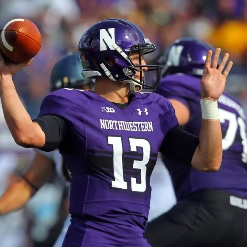 243298b29 Northwestern Wildcats 2014 Uniforms 5-7 (3-5)