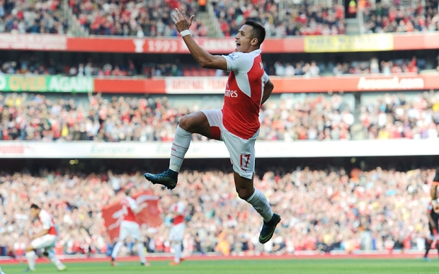 LONDON, ENGLAND - OCTOBER 04: Alexis Sanchez celebrates scoring the 1st Arsenal goal during the Barclays Premier League match between Arsenal and Manchester United at Emirates Stadium on October 4, 2015 in London, England. (Photo by Stuart MacFarlane/Arsenal FC via Getty Images)