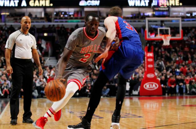 Dec 19, 2016; Chicago, IL, USA; Chicago Bulls guard Jerian Grant (2) drives around defender Detroit Pistons forward Tobias Harris (34) during the first half of the game at United Center. Mandatory Credit: Caylor Arnold-USA TODAY Sports
