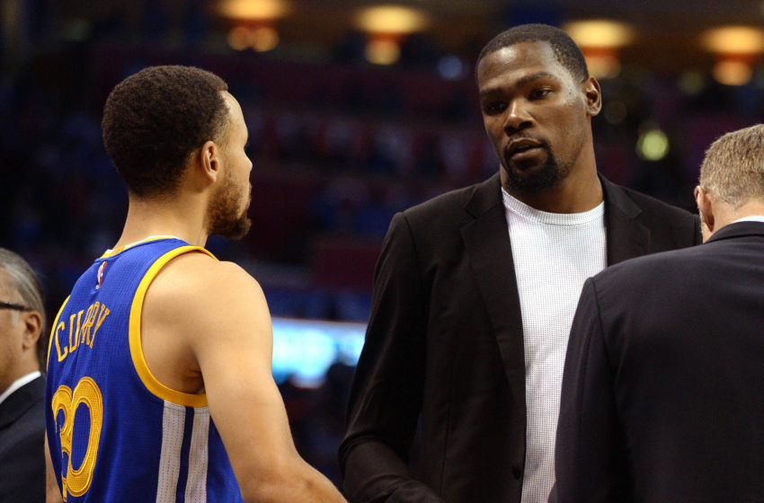 Mar 20, 2017; Oklahoma City, OK, USA; Golden State Warriors forward Kevin Durant (35) speaks to guard Stephen Curry (30) before a game against the Oklahoma City Thunder at Chesapeake Energy Arena. Mandatory Credit: Mark D. Smith-USA TODAY Sports