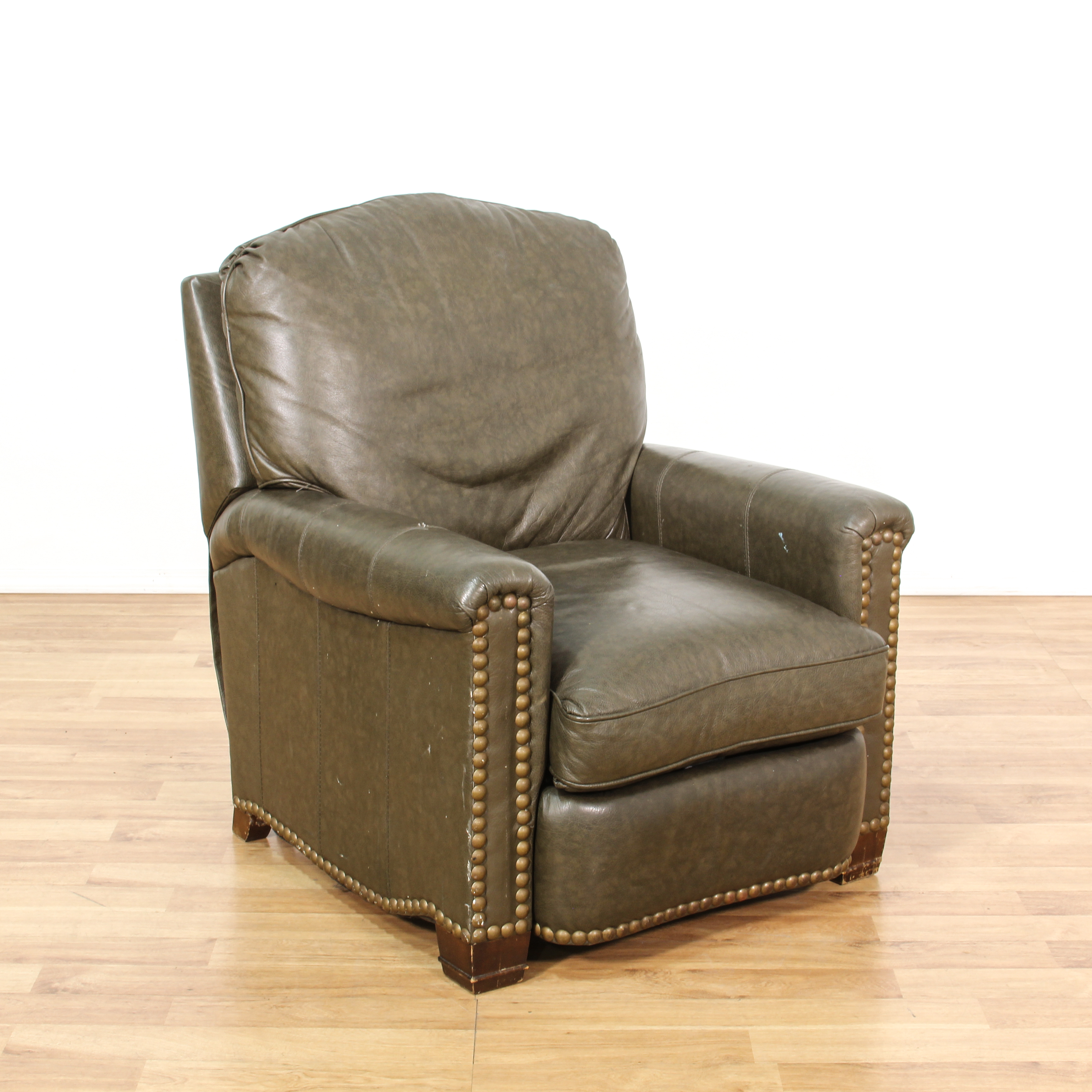 brown leather studded sofa cheers sectional vinyl recliner chair loveseat