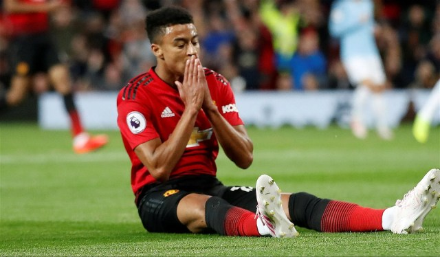 Manchester United attacker Jesse Lingard reacts after missed opportunity vs Manchester City