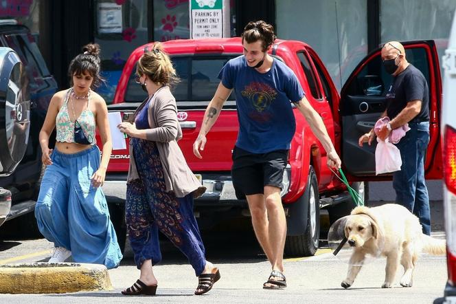 Shawn Mendes and Camila Cabello with their dog Tarzan