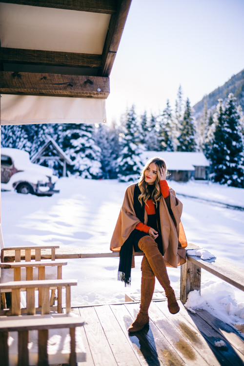 Fashion Bloggers Julia Engel Alpaca Cape Thigh High Boots Snow Bunny Snow Capped Mountains