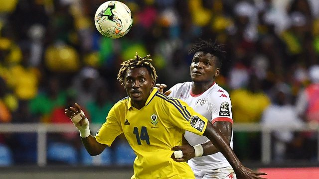 Gabon's forward Serge Kevyn (L) challenges Burkina Faso's defender Patrick Malo during the 2017 Africa Cup of Nations group A football match between Gabon and Burkina Faso at the Stade de l'Amitie Sino-Gabonaise in Libreville on January 18, 2017.  GABRIEL BOUYS / AFP
