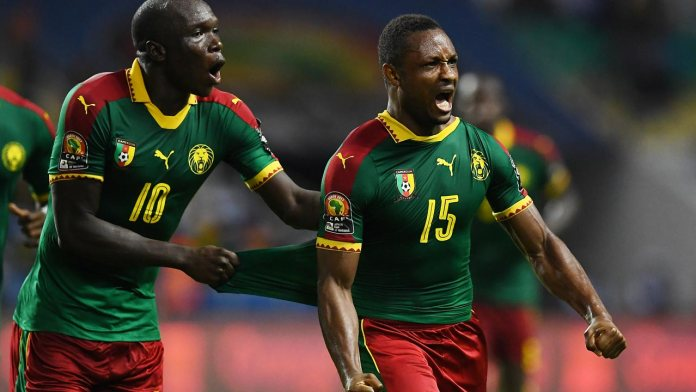 Cameroon's midfielder Sebastien Siani celebrates with Cameroon's forward Vincent Aboubakar (L) after scoring a goal during the 2017 Africa Cup of Nations group A football match between Cameroon and Guinea-Bissau at the Stade de l'Amitie Sino-Gabonaise in Libreville on January 18, 2017.  GABRIEL BOUYS / AFP