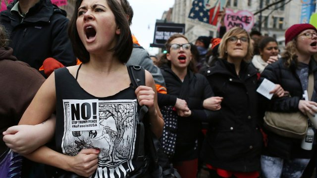 Anti-Trump protesters chant during a demonstration on January 20, 2017 in Washington, DC. Protesters attempted to block an entrance to the inauguration ceremony. Donald Trump was sworn in as the 45th U.S. President today. Mario Tama/Getty Images/AFP  MARIO TAMA / GETTY IMAGES NORTH AMERICA / AFP
