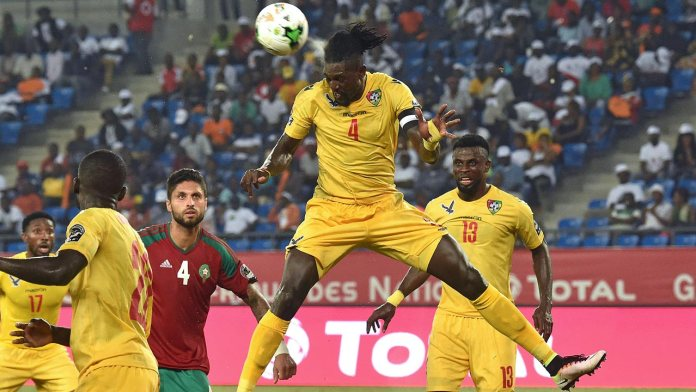Togo's forward Emmanuel Adebayor heads the ball during the 2017 Africa Cup of Nations group C football match between Morocco and Togo in Oyem on January 20, 2017.  ISSOUF SANOGO / AFP