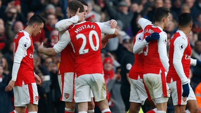 Arsenal's German defender Shkodran Mustafi (3rd L) celebrates with teammates after scoring the opening goal of the English Premier League football match between Arsenal and Burnley at the Emirates Stadium in London on January 22, 2017.  Ian KINGTON / AFP